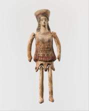 Πήλινη κορινθιακή πλαγγόνα (κούκλα), 5ος αιώνας π.Χ., ύψος 12 εκ., Metropolitan Museum of Art