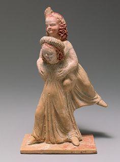 """Πήλινο κορινθιακό ειδώλιο, περ. 300 π.Χ., παράσταση """"εφεδρισμού"""", Metropolitan Museum of Art. Ο εφεδρισμός είναι παιδικό παιχνίδι των αρχαίων: σε απόσταση συμφωνημένη από τους παίχτες τοποθετούσαν μια πέτρα, """"δίορον"""", την οποία προσπαθούσαν να πετύχουν με τόπια και πέτρες· ο νικημένος ήταν υποχρεωμένος να φέρει στους ώμους του τον νικητή έως το σημείο που ήταν ο λίθος· κατά τη διάρκεια της μεταφοράς ο νικητής έκλεινε με τα χέρια του τα μάτια του νικημένου για να μη βλέπει."""
