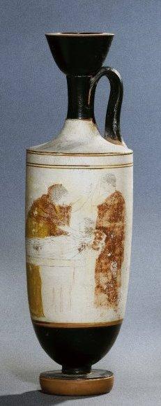 Λευκή λήκυθος, 460-450 π.Χ., πρόθεση νεκρού με λευκό σάβανο,μια γυναίκα με κομμένα μαλλία ως ένδειξη πένθους θρηνεί, στα δεξιά ένας νέος με σηκωμένο το χέρι στο κεφάλι θρηνεί, Βρετανικό Μουσείο.