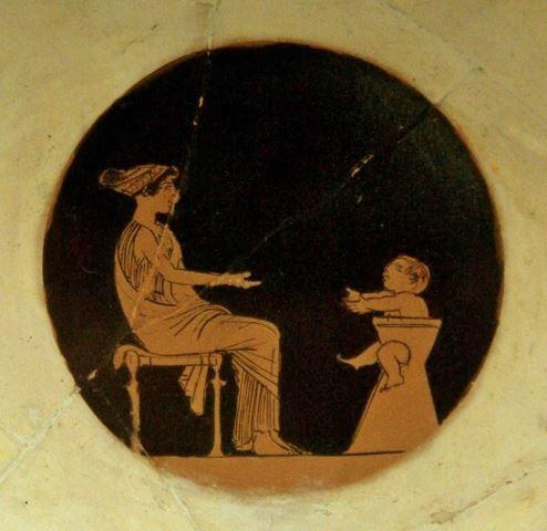 Ερυθρόμορφη κύλικα (εσωτερικό), παιδί σε πήλινο κάθισμα, περ. 460 π.Χ., Musée du Cinquantenaire, Βρυξέλλες.
